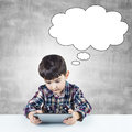 Child using a digital tablet Royalty Free Stock Photo