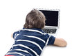 Child using laptop computer on the floor Royalty Free Stock Photo