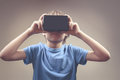 Child using new 3D Virtual Reality, VR cardboard glasses
