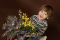 Child with valentine s day flowers holding roses Stock Photography