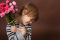Child with valentine s day flowers holding roses Royalty Free Stock Photography