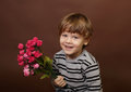 Child with valentine s day flowers holding roses Stock Image