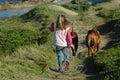 Child walking dogs
