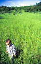 Child walking in meadow Royalty Free Stock Photo