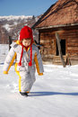 Child walking in snow Royalty Free Stock Images