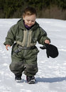 Child walking in snow toddler boy or Royalty Free Stock Image
