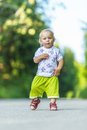 Child walks on road little girl vigorously goes asphalted path Royalty Free Stock Images