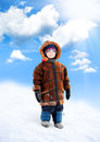 A child walks on a snowy slope Stock Photo
