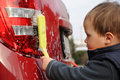 Child washing car Royalty Free Stock Image