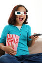 Child watching movie Stock Photo