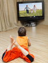 Child watching TV Royalty Free Stock Images