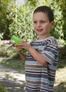 Child with water pistol boy playing gun in a garden Royalty Free Stock Photography