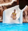 Child on water slide at aquapark. Royalty Free Stock Images