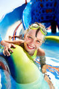 Child on water slide at aquapark. Stock Images