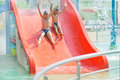 Child on water slide at aquapark boys toboggan Royalty Free Stock Image