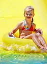 Child water slide aquapark summer holiday Royalty Free Stock Photo