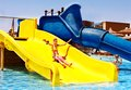 Child water slide aquapark summer holiday Stock Photography