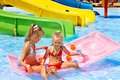 Child water slide aquapark summer holiday Stock Photo