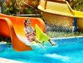 Child on water slide at aquapark summer holiday Royalty Free Stock Image