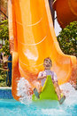 Child on water slide at aquapark summer holiday Royalty Free Stock Images