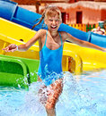 Child on water slide at aquapark summer holiday Royalty Free Stock Photo