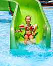 Child on water slide at aquapark summer holiday Stock Images