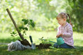 Child watering just planted tree. Children will save the earth Royalty Free Stock Photo