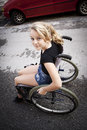 Child in wheelchair cute disabled girl riding a on the road Stock Image