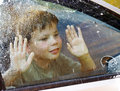 Child and window on a wet rainy day Stock Photos