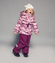 Child in winter clothes children kids down jackets fashion Stock Image
