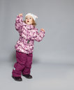 Child in winter clothes kid down jackets fashion Royalty Free Stock Images