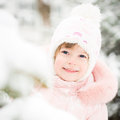 Child in winter park happy playing Royalty Free Stock Photography