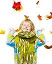 Child in woolen scarf playing with maple leaves over white background Royalty Free Stock Photos
