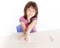 Child writing at desk with pencils and notebook Royalty Free Stock Photos