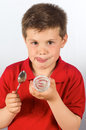 The child of yogurt photograph a eating over white background Stock Photography