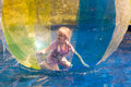 Child in the zorb Stock Images