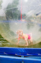 Child in zorb a happy Royalty Free Stock Photo