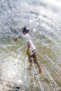 Child in the zorbing ball has fun Stock Image