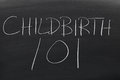 Childbirth 101 On A Blackboard Royalty Free Stock Photo