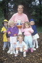 A childcare worker with her group of children Royalty Free Stock Photo