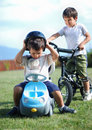Childhood activity with truck toy and bike on gree Royalty Free Stock Photos