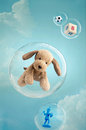 Childhood dreaming toys floating in soap bubbles in the sky Stock Photos