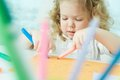 Childhood fun pretty child having drawing at kindergarten Royalty Free Stock Photos