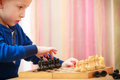 Childhood. Intelligent boy child kid playing chess. At home. Stock Image
