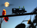 Childhood magical concept image of with blurred carnival lights a classic toy train and starry night sky Stock Photography