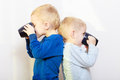 Childhood two brothers little boys drinking tea happy funny children kids standing back to back sibling rivalry Stock Image