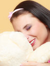 Childish young woman infantile girl in pink hugging teddy bear toy Royalty Free Stock Images