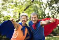 Childlike seniors wearing superhero costumes Royalty Free Stock Photo