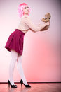 Childlike woman with teddy bear toy mental disorder concept young wearing like puppet doll holding studio shot Stock Photo