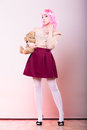 Childlike woman with teddy bear toy mental disorder concept young wearing like puppet doll holding studio shot Stock Photography
